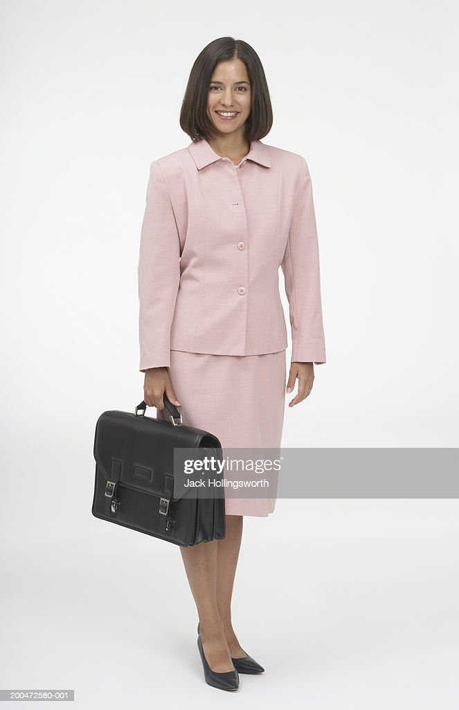 Portrait of a businesswoman holding a briefcase : Stock Photo