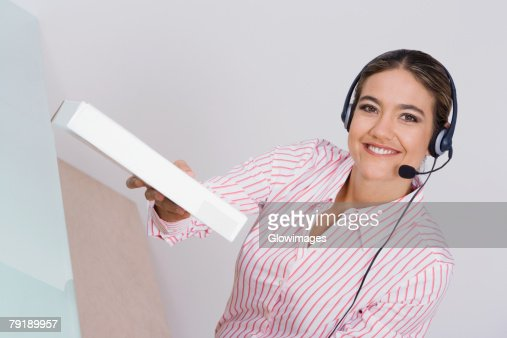 Portrait of a businesswoman holding a package and smiling : Foto de stock
