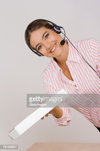 Portrait of a businesswoman holding a package : Stock Photo