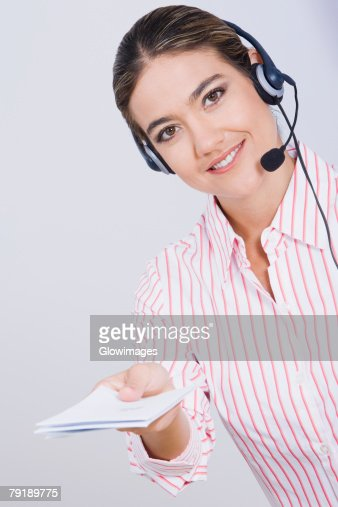 Portrait of a businesswoman holding documents and smiling : Stock Photo