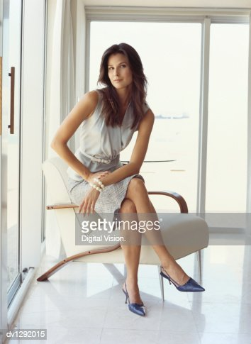 Portrait of a Businesswoman Sitting on an Armchair : Stock Photo