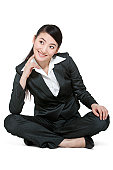 A portrait of a businesswoman sitting on the floor