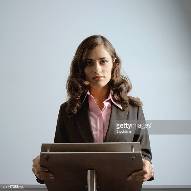 portrait of a businesswoman standing at a podium