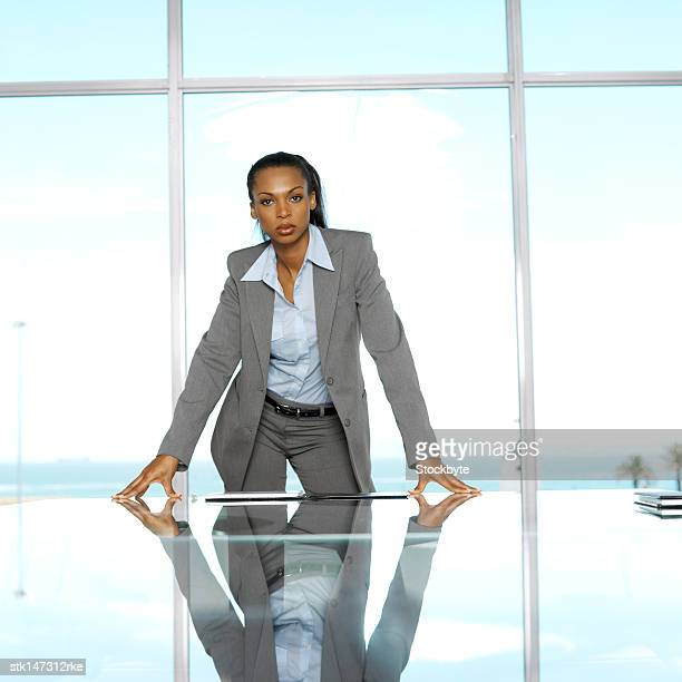 portrait of a businesswoman standing in a conference room