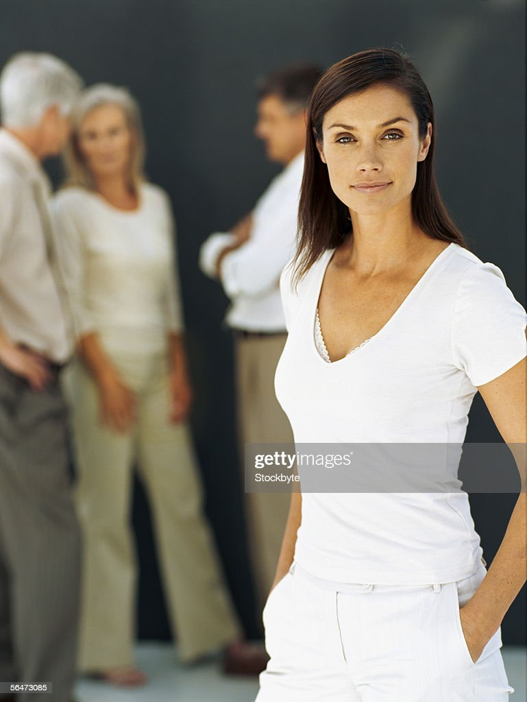 portrait of a businesswoman standing with her hands in pockets : Stock Photo