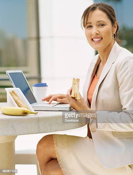 portrait of a businesswoman using a laptop