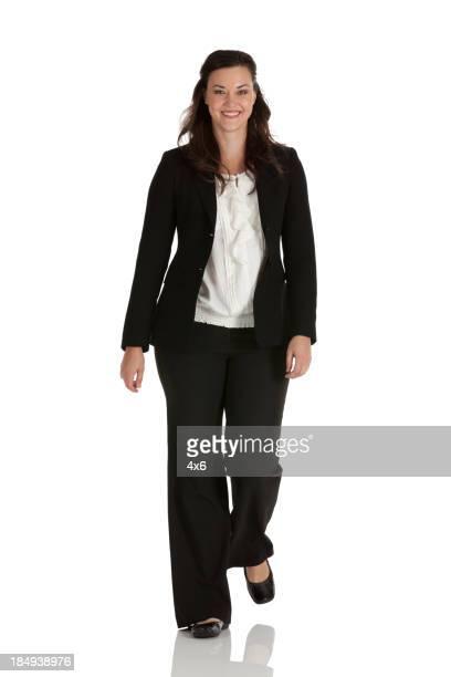 Portrait of a businesswoman walking