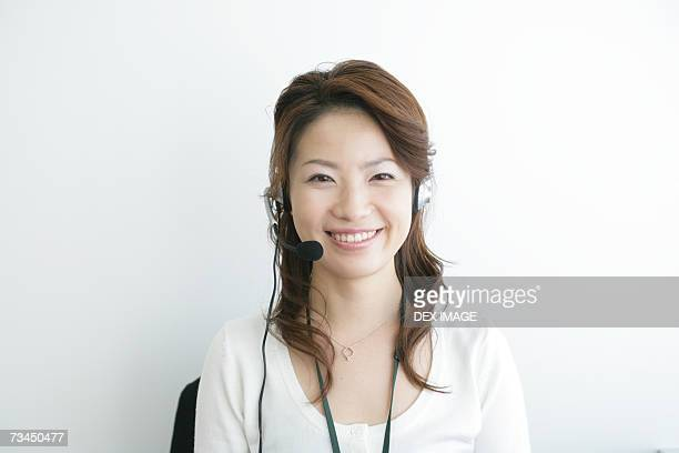 Portrait of a businesswoman wearing a headset and looking cheerful