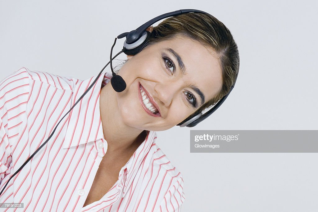 Portrait of a businesswoman wearing a headset and smiling : Foto de stock