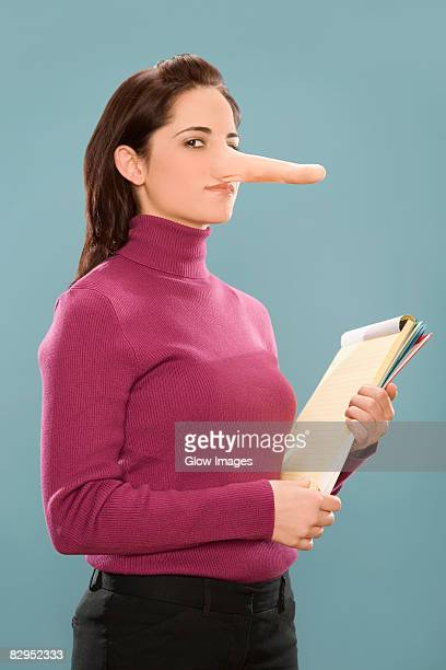 Portrait of a businesswoman with long nose