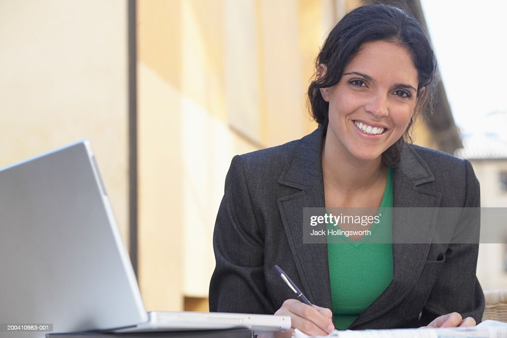 Portrait of a businesswoman working outdoors : Stock Photo