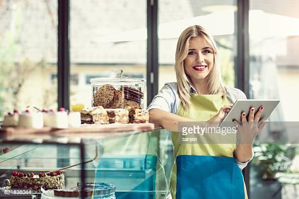 Portrait of a Cafe Owner Holding a Digital tablet