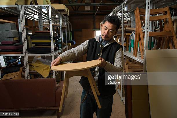 Portrait of a carpenter inspecting his work