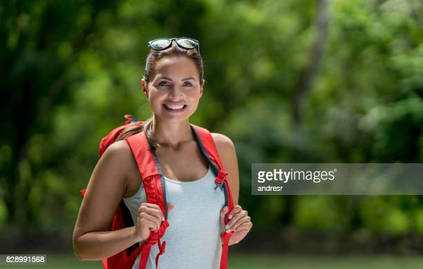 Portrait of a casual woman hiking and looking very happy