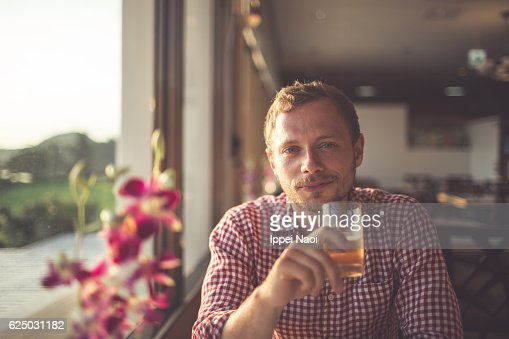 Portrait of a Caucasian man with drink : Stock Photo