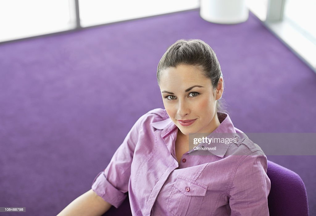 Portrait of a Caucasian woman in modern office cafeteria