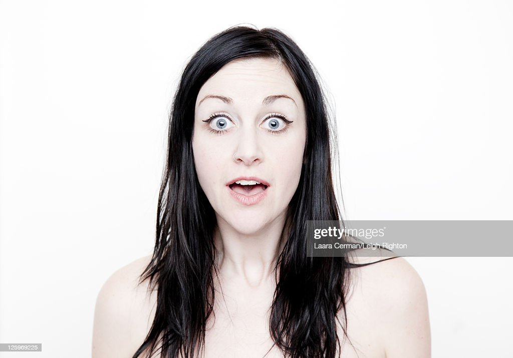 Portrait of a Caucasian woman (28 years old) with surprise expression in front of a white background : Stock Photo
