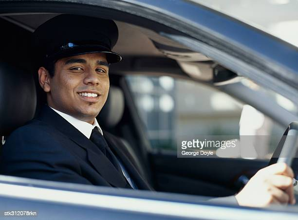 portrait of a chauffeur driving a car