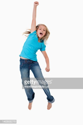 Portrait of a cheerful girl jumping : Foto de stock