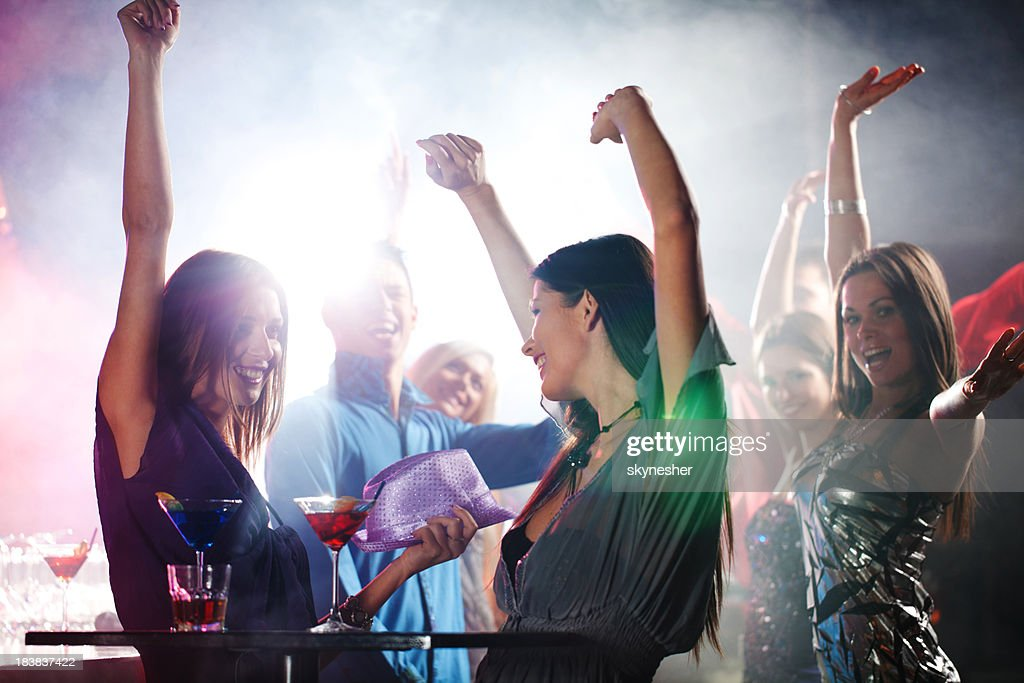 Portrait of a cheerful girls dancing at party.