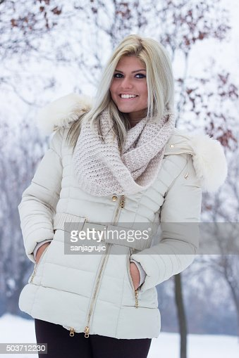Portrait of a cheerful teenage surrounded by snow : Stock Photo