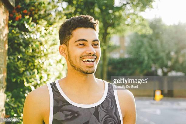 Portrait Of A Cheerful Young Man Outdoors After Workout