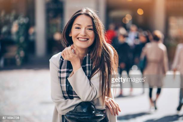 Portrait of a cheerful young woman at sunlight