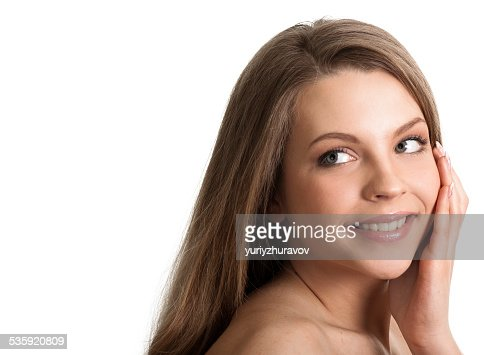 Portrait of a cheerful young woman looking at copyspace : Stock Photo