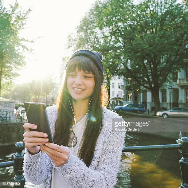 Portrait Of A Cheerful Young Woman Texting