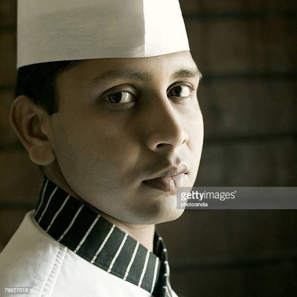 Portrait of a chef in front of a brick wall