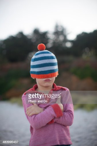 portrait of a child on the beach with a hat