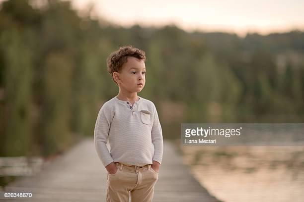 Portrait of a child standingon a dock