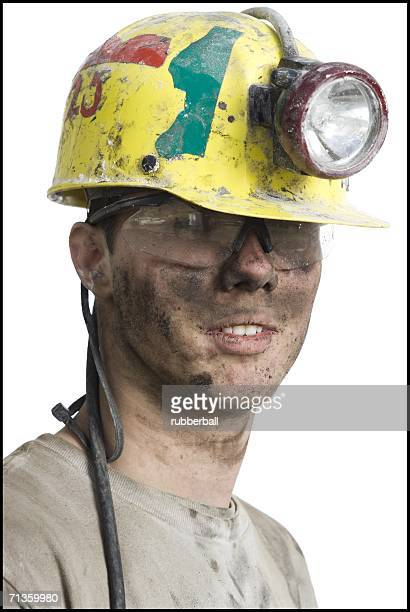 Portrait of a coal miner wearing a hardhat