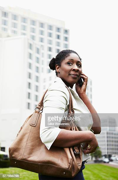 portrait of a content afro-american businesswoman taking on her smartphone