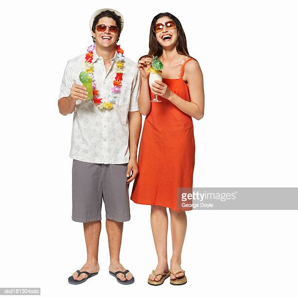 Portrait of a couple drinking cocktails