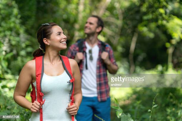 Portrait of a couple hiking and looking very happy outdoors
