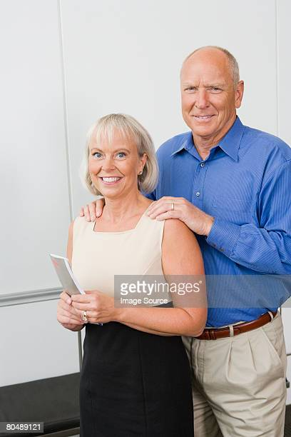Portrait of a couple holding tickets