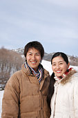 Portrait of a couple in winter, smiling
