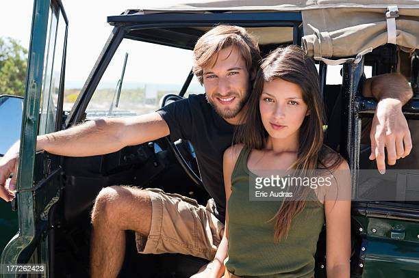 Portrait of a couple on SUV