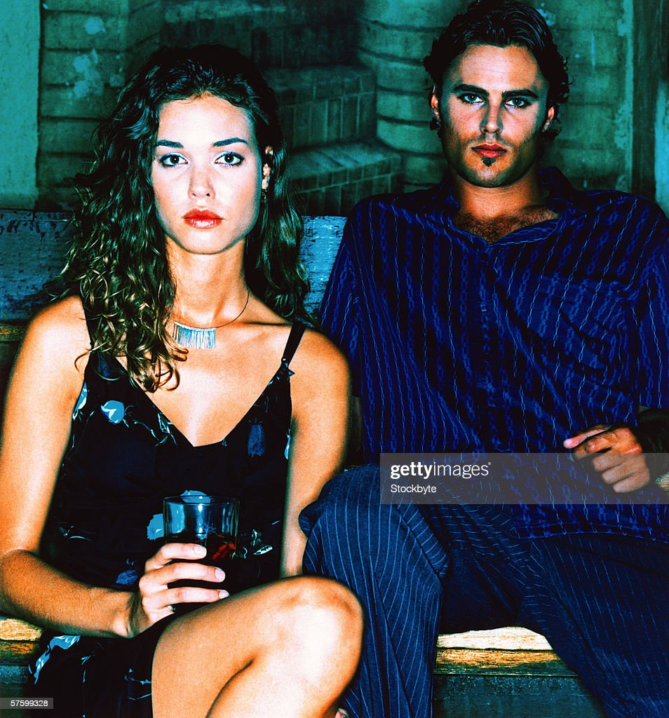 portrait of a couple sitting in a club : Stock Photo