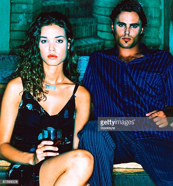 portrait of a couple sitting in a club