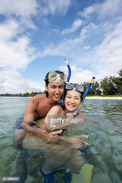 Portrait of a Couple Snorkeling in the Sea