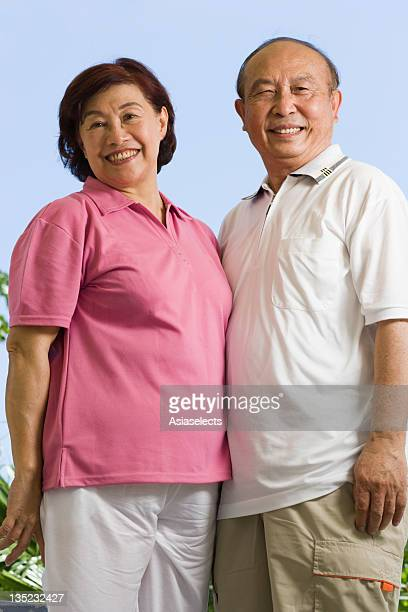 Portrait of a couple standing together and smiling