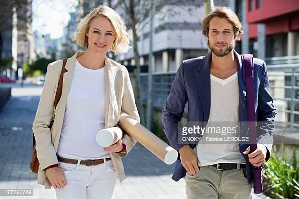 Portrait of a couple walking on a street