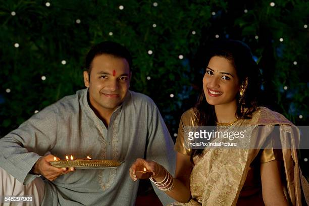 Portrait of a couple with diyas