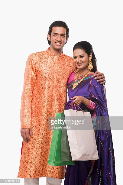 Portrait of a couple with shopping bags on Gudi Padwa festival
