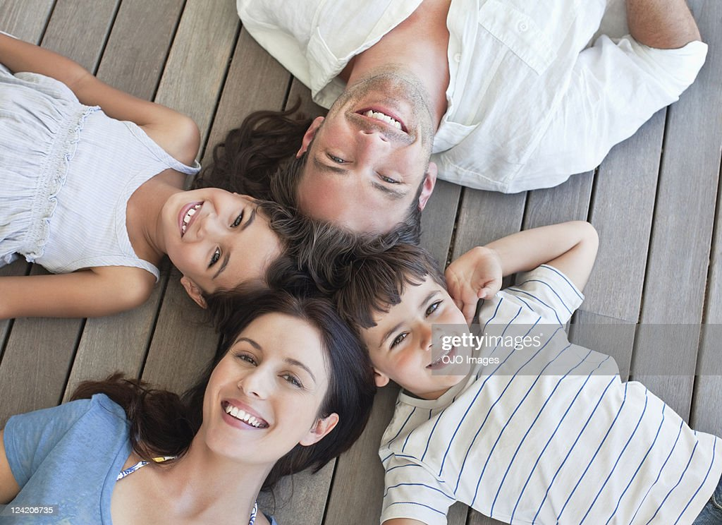 Portrait of a couple with son and daughter smiling : Stock Photo