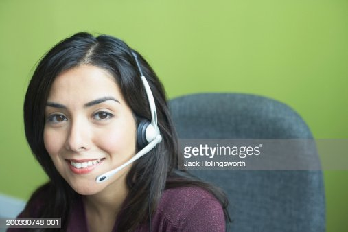 Portrait of a customer service representative smiling : ストックフォト