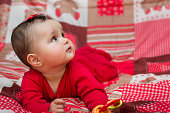 Portrait of a cute six-month baby girl in red
