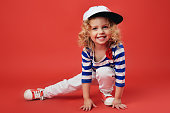 Portrait of a cute little girl in fashionable clothes